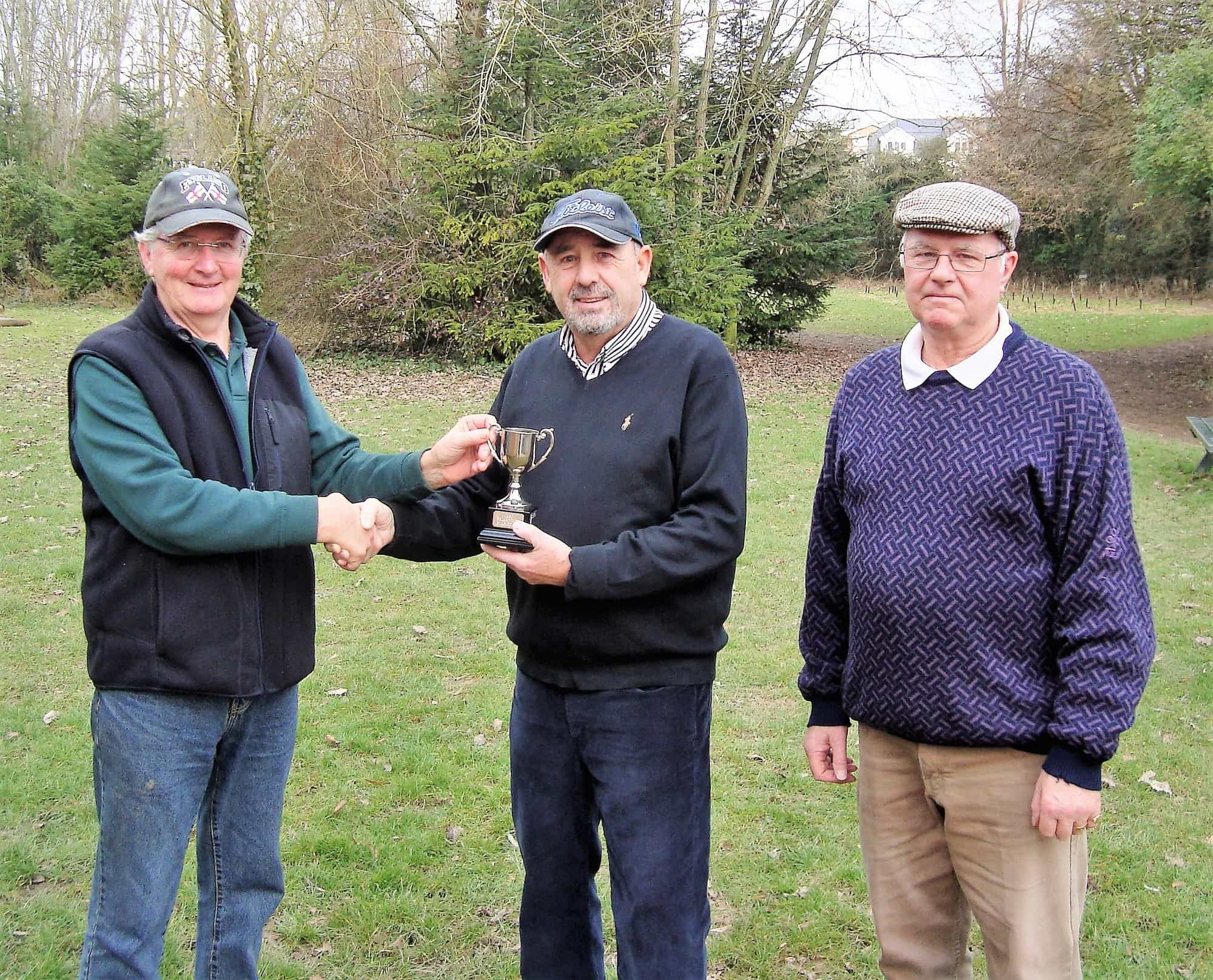 Last year's winner, Peter Barclay (left), presents Richard Poyser (centre)with the cup in the presence of the sponsor Brian White (right).