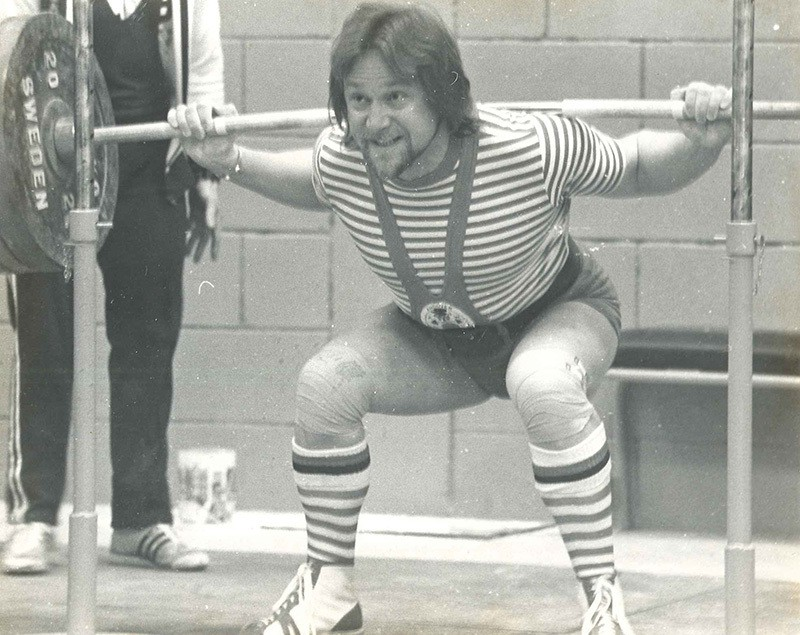A young Robyn Brown power lifting